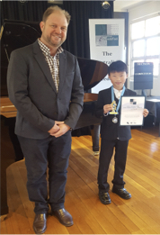7- 12 years winner of the Ann Thompson Encouragement Award, Victor Ni with Adjudicator, Hamish Tait